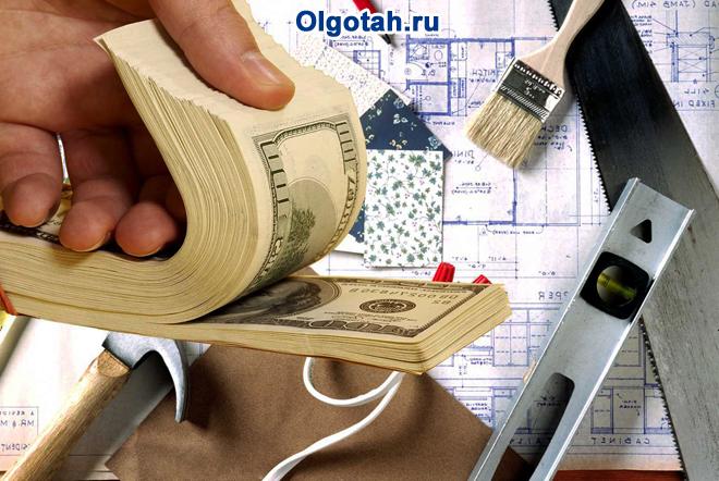 Деньги, строительные инструменты, план квартиры